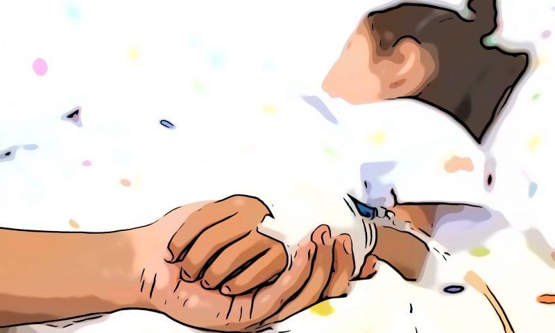sick kid holding hand