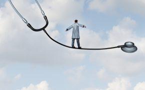 balancing doctor on stethoscope