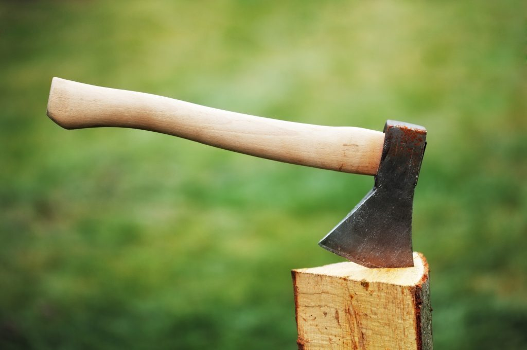 Axe chopping block of wood