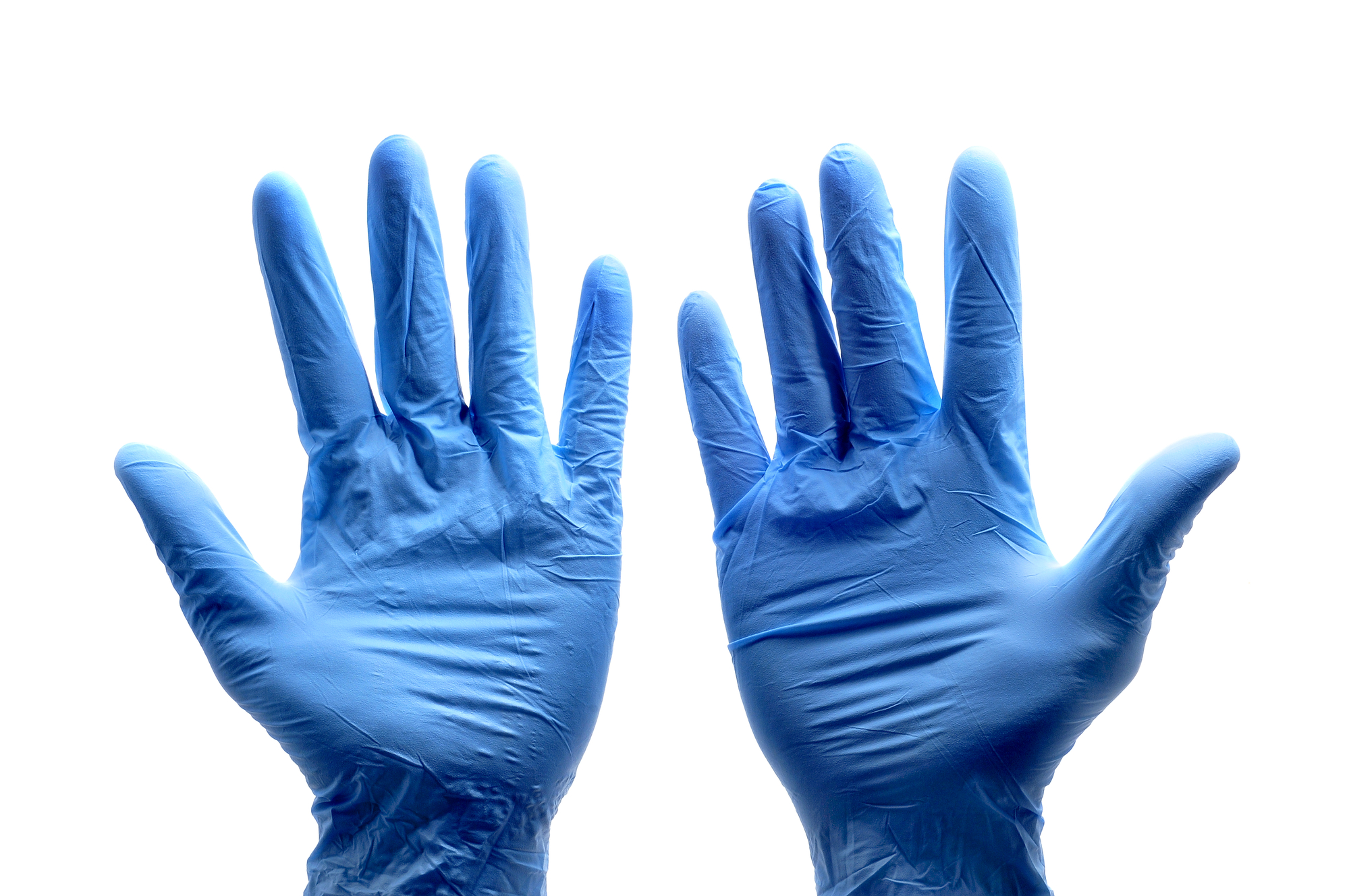 Someone wearing  a pair of blue surgical gloves