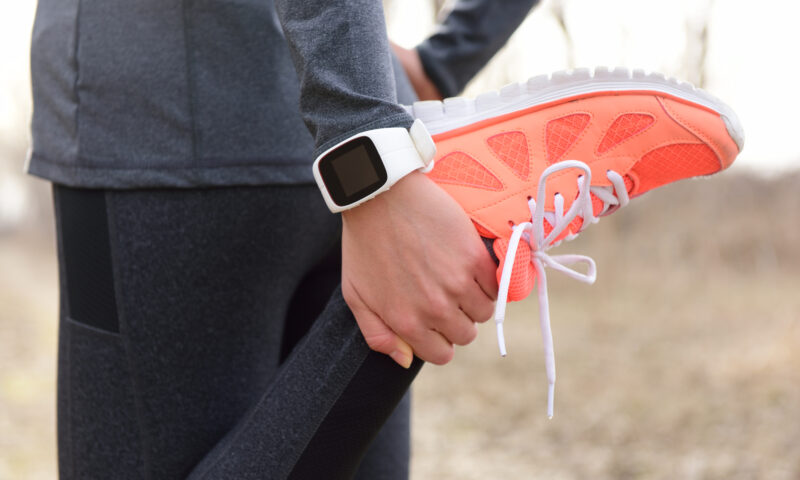 smart watch person running and stretching