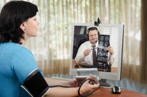 lady using telemedicine with doctor